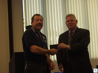 Jack LeVine receives his Citizens Leadership Academy graduation plaque from Chris Knight, the director of  the office of administrative services  for the City of Las Vegas