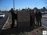 City Manager Doug Selby, Gary Reese, John Delikanakis and Southridge President Michael Hanratty Unveil the Monument Sign
