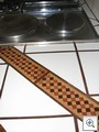 Custom inlaid wood mosaic in the double island kitchen at 1700 Chapman Drive in Historic Downtown Las Vegas