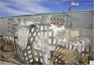 A rendering of the Lou Ruvo Brain Institute, designed by Frank Gehry, covers the fence surrounding the building's construction site at Union Park in Las Vegas.  Leila Navidi/Las Vegas Sun