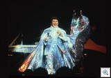 Liberace on stage wearing Glittering Costume