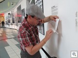 Brian Paco Alvarez installs the finishing touches on