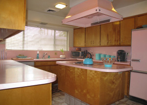 absolutely original with matching pink GE appliances, including double ovens, dishwasher, cooktop and fridge.