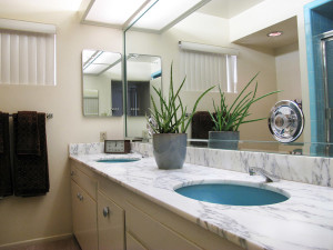 This is the blue guest bathroom off the hallway. Matching tub, tilework, toilets and sinks are all intact.